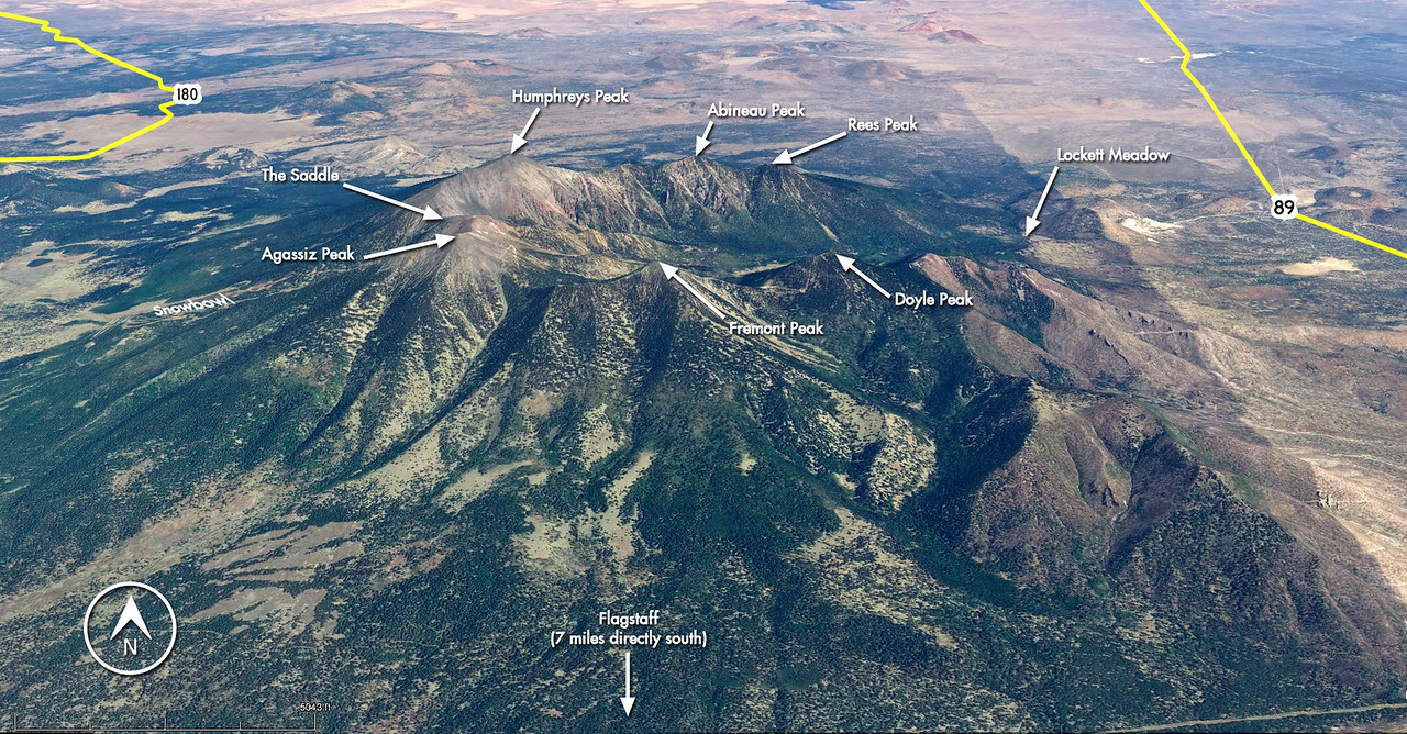 This aerial view illustrates the range's complex arrangement of mountains, canyons, and meadows that together make up the San Francisco Peaks Range and Wilderness Area.