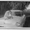 1954, Jackie on Dad's 1953 Ford Fairlain.  Possibly in Anahuac, Texas.
