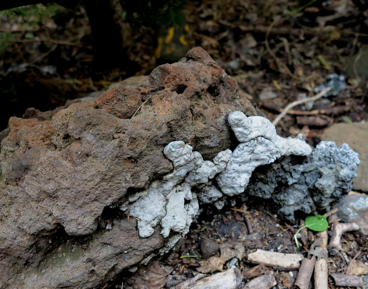 Some of the melted aluminum was found to have adhered to pieces of exposed lava rock.