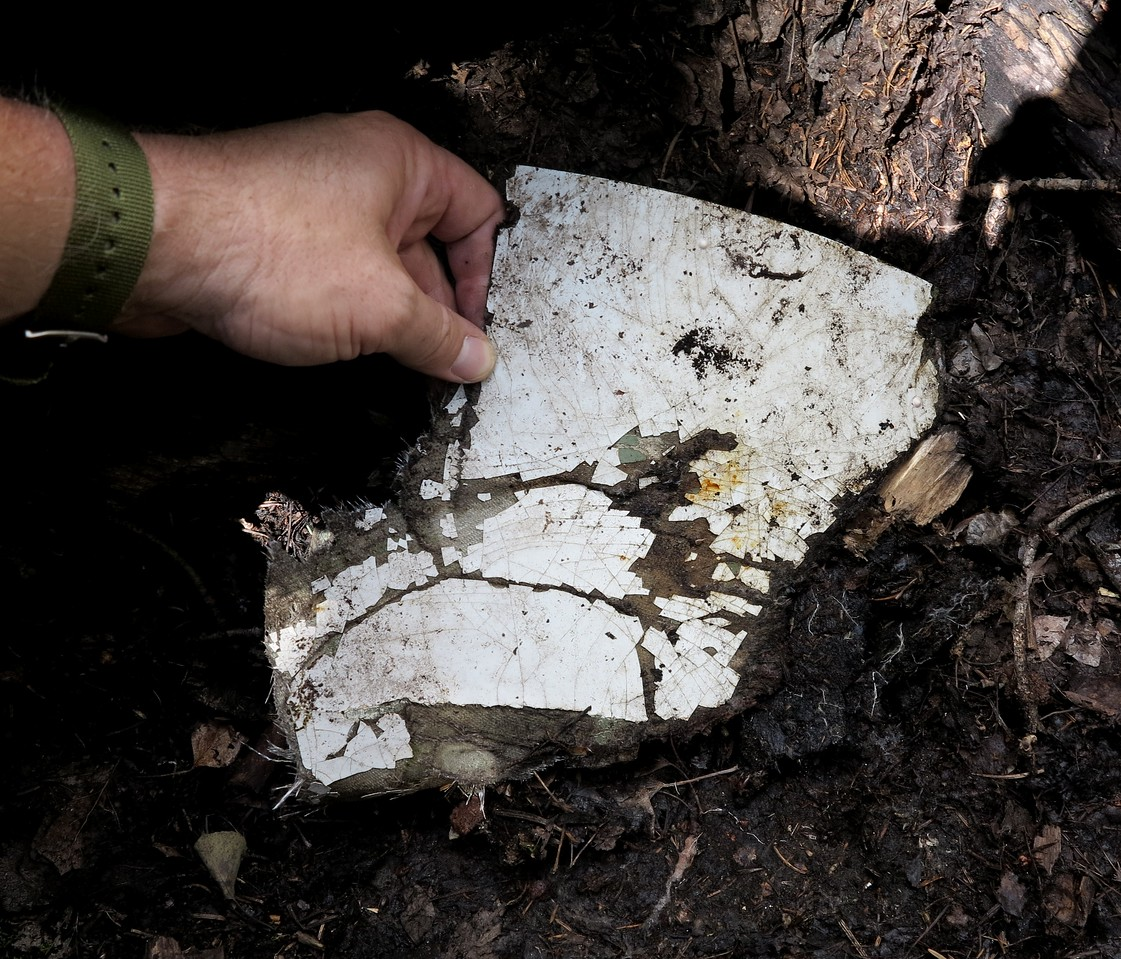 This fragment was painted with the overall white paint of the aircraft.<br /> <br /> The aircraft's overall white paint scheme camouflaged the wreckage on snow covered Rees Peak. A change in the appearance of the snow alerted searchers from the air of the crash site location.