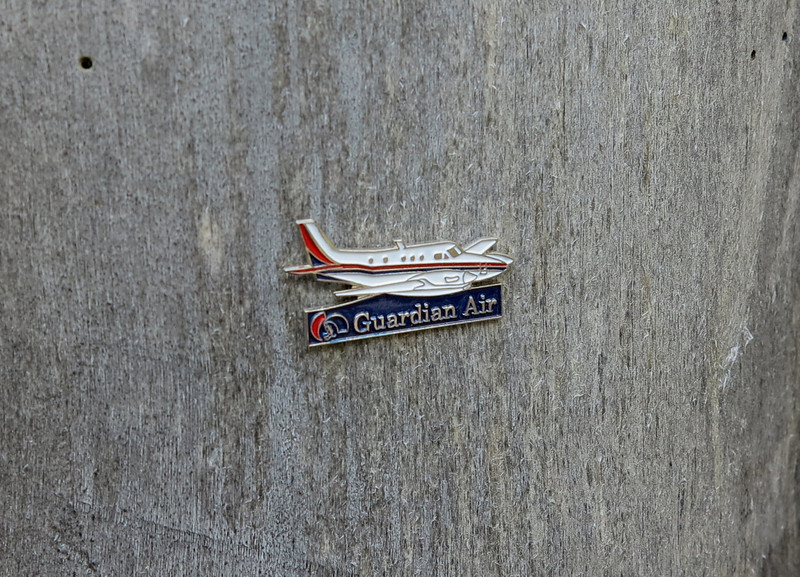 During my visit to the site I left this small Guardian Air pin in memory of the crew that lost their lives on Rees Peak.<br /> <br /> REST IN PEACE<br /> <br /> Stephen Tulley<br /> Laura Parada<br /> Karen Peebles<br /> <br /> ***THE END***