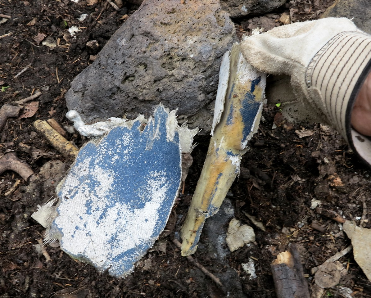 These two pieces of fiberglass material had dark blue paint characteristic of Guardian Air's paint scheme.