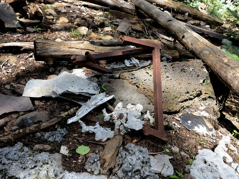 The seat frame was found amid melted aluminum and other debris.
