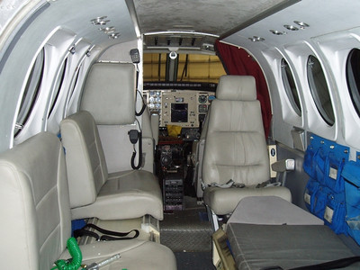 The interior cabin of the Guardian Air Beech E-90 was typical of most air ambulance aircraft. <br /> <br /> Guardian Air operated their aircraft with only one pilot. The flight nurse and other technicians would sit in the cabin and tend to the patient.