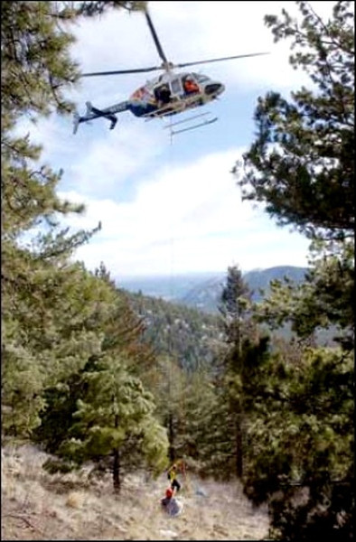 A Department of Public Safety helicopter hovers up-mountain of the crash site waiting to remove the bodies from the site.<br /> (Arizona Daily Sun)
