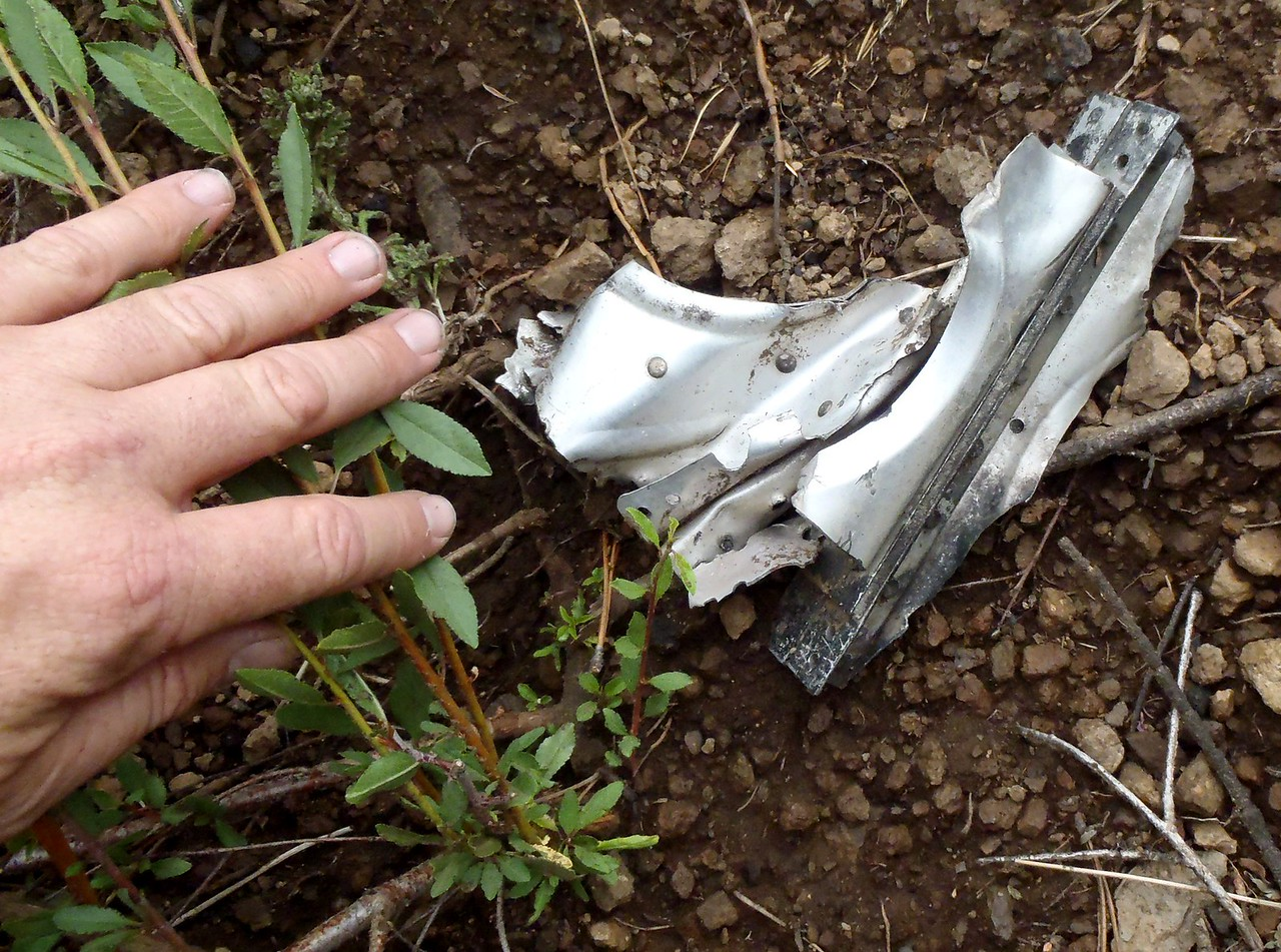 One of the largest structural aircraft fragments located at this crash site is only a few inches in length.