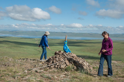 Shinee and Inge circling the ovoo, Lake Oghii in the distance.