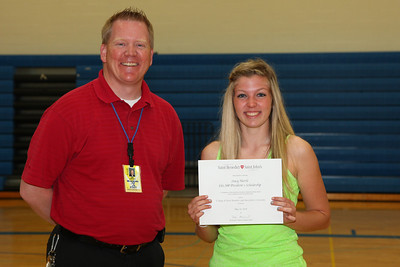 Principal Widvey presented Stacy Hurrle with a $16,500 President's Scholarship in recognition of high scholastic achievement, leadership abilities, talents and an outstanding record during high school from the College of Saint Benedict and Saint John's University.