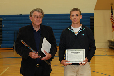Cameron Hunt received the Royale B. and Eleanor M. Arvig Memorial Scholarship from Arvig representive, John Wallach.