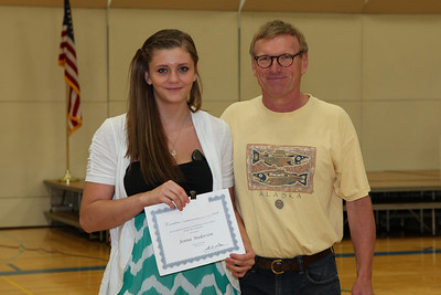 Art instructor Mike Linn presented the Creative Achievement Award to Jenna Anderson.