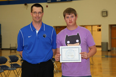 Head basketball coach Jay Klein presented Ben Serbus with a Academic All-State Honorable Mention Certificate.