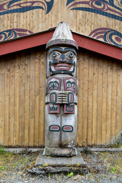 """Welcoming figure, Big House, Klemtu, Swindle Island, British Columbia<br /> <br /> Klemtu is one of the aboriginal villages in the Great Bear Rainforest.  This carving in front of the recently built long house in the village welcomes people into the house, which is used for ceremonial occasions such as traditional feasts and dances, celebrations and memorials. For a view of the whole building and some interesting information about it, see here: <a href=""""http://goo.gl/8a4ggi"""">http://goo.gl/8a4ggi</a><br /> <br /> The welcoming figure is a man holding two coppers (shields) in his arms, representing each of the two bands living at Klemtu: the Kitasoo tribe of the Tsimshian Nation and the Xai'xais Tribe of the Hjehjish Nation who live together at Klemtu and share a joint government."""