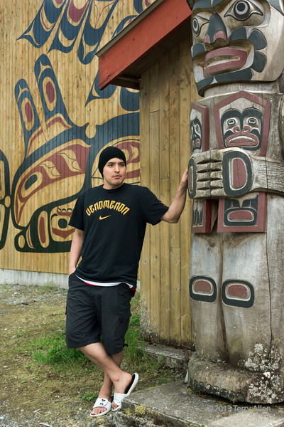 Klemtu guide explaining the significance of the welcome figure, Big House, Klemtu, British Columbia