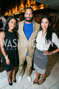 "Manal Elhag, Christian Duffus, Kheira Benkreira. Photo by Alfredo Flores. Knock Out Abuse Jr. Board ""Party for a Cause."" Teddy and The Bully Bar. July 10, 2014"