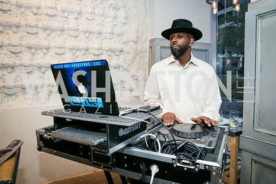"DJ Tye. Photo by Alfredo Flores. Knock Out Abuse Jr. Board ""Party for a Cause."" Teddy and The Bully Bar. July 10, 2014"