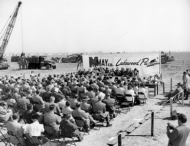 """Groundbreaking for the May Company building took place on October 14, 1950 as 300 business leaders and state and county officials looked on.  The developers of Lakewood made Lakewood Center the new community's """"downtown"""" – a novel idea in 1950. Surrounded by thousands of homes, the new shopping center was just minutes away from shoppers.   Surveys showed that nearly 25 percent of prospective consumers in Los Angeles County were located within a 30-minute driving radius. As the west's largest shopping center, promoted as """"the 154-acre 'shopping heart' of Lakewood"""" (260 acres if the parking lot acreage was included), Lakewood Center would be a city in itself."""