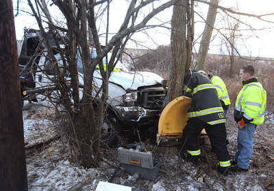 Landscaping truck plow caught on tree in Chelmsford accident