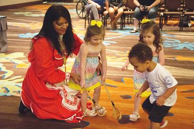 Mandy Lawson teaches Choctaw children how to play stickball.