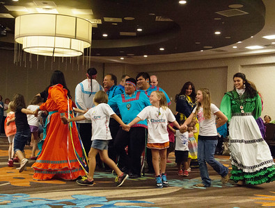 Choctaw Dancers and members from the audience dance the Snake Dance.
