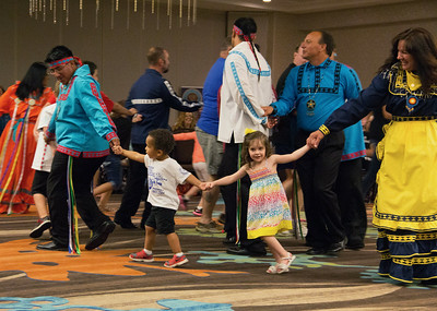 Choctaw Dancers and children from the audience dance the Snake Danc