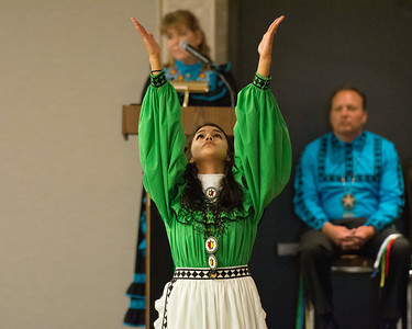 Beckah Boykin signs a prayer during the opening of the Lawton Choctaw Cultural Meeting.