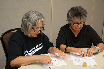 Carol Dodd (left) and Joanna Cozby (right), both from Burkburnett, Texas put all of their attention on the beaded jewelry they are working on.