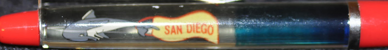 "Back: half blue and clear<br /> Front:  half blue and clear<br /> Floater:  dolphin pulling banner reading ""San Diego""<br /> Style: Classic<br /> Color: red<br /> Cost: $6.00<br /> Category: Southern California"