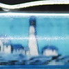 Back: U.S.S. Constitution, Boston<br /> Front:  lighthouse<br /> Floater:  schooner <br /> Style: Classic<br /> Color: brown marble/black<br /> Cost: $3.00 bubble<br /> Category: States K L M N