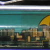 Back: Seattle, Washington<br /> Front:  cityscape <br /> Floater:  three umbrellas<br /> Style: Classic<br /> Color: blue<br /> Cost: $6.00<br /> Category: Washington State