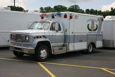 The Fire Marshal's first bomb disposal truck was this 1989 Chevrolet/Wheeled Coach, which was an old ambulance from Sterling Rescue.  Sterling Rescue had two similar ambulances, and they were the first monster medics delivered in Loudoun County.  While in service in Sterling, they were painted white with green stripes.  This photograph was taken at the county yard in Leesburg just prior to the truck going out of service.