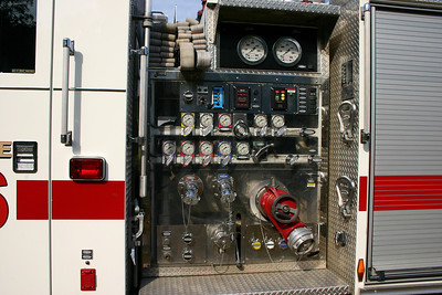 "Although it is difficult to see in this photograph, Engine 99 came equipped with a very unique feature - a ""see through"" pump panel.  As a training engine, operators could have a better understanding and a view of the plumbing behind the pump panel.  The officer side also had this feature.  Ultimately, when this 2002 Pierce Enforcer was re-assigned as a county wide reserve engine, the pump panel was switched out to a regular panel."