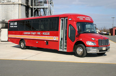 "The Loudoun County Fire Department shops did some great work on the graphics and outfitting of Bus 690.  I saw it at the shops when it was delivered and looked a bit plain in its red color.  The 2011 Freightliner M2/Champion Bus Company has seating for 33 and a larger ""cage"" area in the rear to hold gear, equipment, etc.  Photographed in November of 2012 at the burn building in Leesburg."