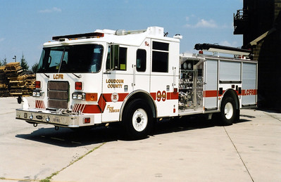 Training Center Engine 99 as photographed in 2002 at the old burn pad.  After serving three years as Engine 99, it was re-assigned as Engine 16 in Neersville.  Today, it is a reserve engine in the county fleet.  Engine 99 is a 2002 Pierce Enforcer  1250/750.