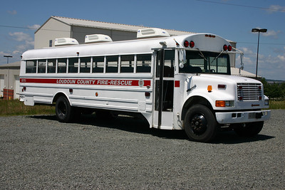 """Bus 699"" is an old Loudoun County school bus used to transport recruits and as a rehab unit when needed.  It is a 1990 International that was received by the fire and rescue department in 2004.  It is housed at the Training Center.  Note the three air conditioning units on top."