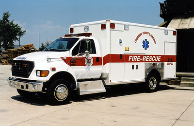 The first new ambulance assigned to the Training Center was this unusual 2002 Ford F650 built by Wheeled Coach.  It is currently Ambulance 699.  This photograph was taken at the old burn pad shortly after being placed into service.