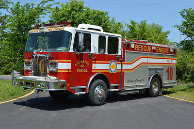 The volunteers at Lucketts are the primary operators of Engine 610B.  The county changed the designation of this engine from Rescue Engine 10.  Engine 610B is an unusual one in terms of fire trucks.  It is a 2002 Spartan Mountain Star 4x4 built by Saulsbury and equipped with a 1500/750.  The pump panel is in the drivers side rear compartment and the discharges are in the rear.  Photographed in May of 2014.