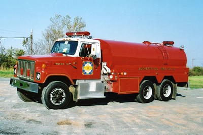 Tanker 10 received a facelift in 1990, a new International cab was attached to the 1977 4-Guys body.  Equipped with a 350/3000, sn- F133.