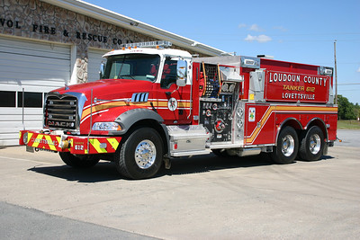 "Photographed in September of 2013, the new Tanker 612 is a 2012 Mack Granite with a 2013 Pierce body.  It is equipped with a 1500 gpm pump and carries 3000 gallons of water.  It replaced the original ""large"" county purchased tanker - a 2005 International/Pierce 3000 gallon that originally saw service in Hamilton."