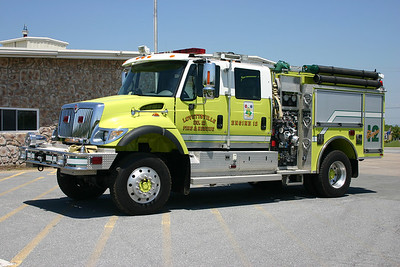 "Originally placed into service as ""Attack 12"", additional equipment was added to this truck to change its designation to Engine 612 in 2007.  It is a Urban Interface Unit designed to be able to travel off roads when needed.  Engine 612 is a 2003 International 4700 4x4 built by Pierce and equipped with a 1000/500/30."