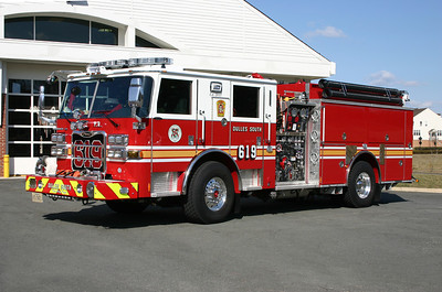 """Engine 619 as photographed on the back ramp of Fire Station 19 in April of 2013.  It is a 2012 Pierce Arrow XT with a 1500/750/50.  This is one of the first county engines that I have seen where in addition to the county logos, the Station 19 emblem is on the engine as well as the front bumper saying """"Dulles South The Big Top"""".  The Big Top refers to the original Station 19 that was a large tent.  That tent today is located at the Training Center near the burn building."""