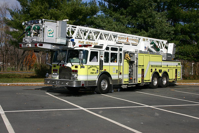 Tower 602 from Purcellville - a 2002 KME Aerial Cat 102'  1250/300.  Note the combination of regular and roll up compartment doors.