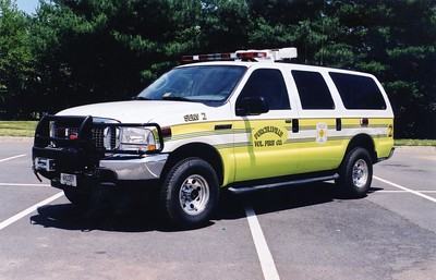 Former SERV 2, a 2003 Ford Excursion/FastLane.  Note the unusual light tower on the roof.