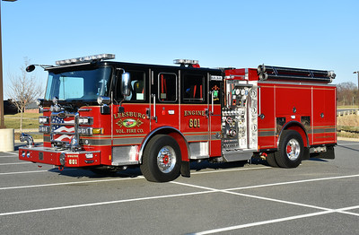 Leesburg Engine 601, a 2016 Pierce Enforcer 1500/750/30 with job number 30156.  The mural's of the department's 1929 Seagrave are on the front doors.  Dedicated to J.B. Anderson II with mural's and the bell on the front bumper.  Engine 601 was photographed just after its dedication ceremony on 2/26/2017.