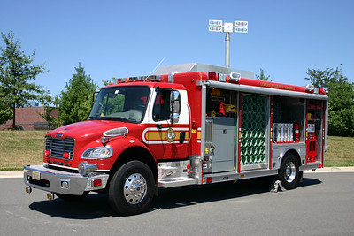 Compartment doors rolled up and the light tower partially up on Mobile Air Unit 623.