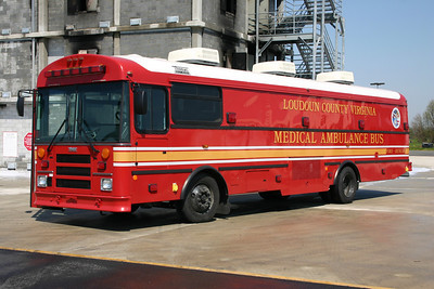 As part of another grant, a group of  Washington D.C. metropolitan area fire departments received large Medical Ambulance Buses for mass casualty incidents.  Seven were delivered - Loudoun County, Arlington County, Fairfax County, Washington D.C., Montgomery County, MD (2), and Prince George's County, Maryland.  Loudoun's Medical Ambulance Bus (MAB) was originally kept at the Training Center and then transferred to Station 23 in 2009.  It is a 2007 Thomas Built Bus outfitted by Sarton Services.  This photograph was taken next to the burn building at the Training Center shortly after being placed into service.