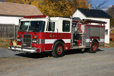 Old Wagon 4 at Round Hill was originally a Pierce demonstrator purchased by Round Hill in 1996.  It is a 1994 Pierce Dash  1250/750 with rear entry crew doors located by the top mount pump panel.