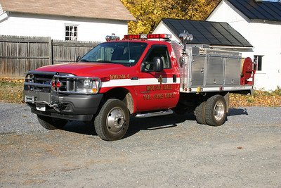 The flatbed brush truck is a common truck style in Loudoun County.  Brush 604 is a 2002 Ford F550 built by Elite and equipped with a 150/300.