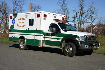 The officer side of 617-2, a 2006 Ford F450 4x4/Horton.