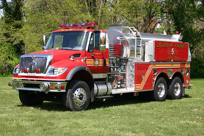 Old Tanker 5 was a county purchased 2005 International 7600/Pierce  1500/3000.  It was re-assigned to Lovettsville Station 12 in 2011, and then Tanker 680 in 2013.  Photographed at the local park just across the street from old Fire Station 5.