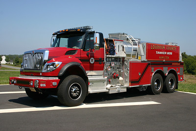 Loudoun County provided Tanker 605, a 2009 International 7600/Pierce  1500/3000.  This replaced Hamilton's 2005 International/Pierce tanker which was re-assigned to Tanker 612 in Lovettsville, and later became a county reserve.  This photograph became a bit of a challenge.  After the tanker was moved to the helipad for photographs, I realized how tall the truck was and the angle would have been a bit distorted.  A Hamilton volunteer moved his pick up truck close to the helipad which allowed me to photograph Tanker 605 while standing in the pick up truck bed.